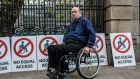 Michael Doyle from Carlow, a member of the Irish Wheelchair Association,  outside Leinster House on Wednesday. Photograph: James Forde for The Irish Times