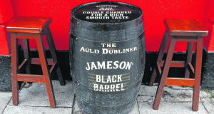 From pub to podcast: Jameson whiskey barrel table in Temple Bar, Dublin.