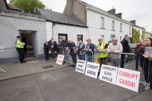 STREET PROTEST: Demonstrators rail against the Courts Service, Garda Siochana and politicians outside Strokestown Court in Co Roscommon as an assault case against former garda Kevin Taylor was adjourned until October. Photograph: Brian Farrell