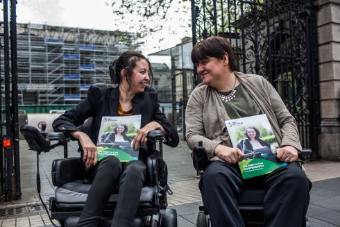 SEEKING RIGHTS: Niamh Ni Rourke (spokeswoman), who has a rare type of cancer, and Joan Carthy, advocacy officer with the Irish Wheelchair Association, outside Leinster House in Dublin, where they campaigned for the right to live independently. Photograph: James Forde