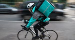 Deal gives Amazon a stake in both delivery and preparation through 'dark kitchens' in which some Deliveroo meals are made. Photograph:  Daniel Leal-Olivas/AFP/Getty