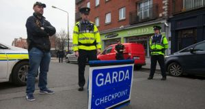 Gardaí at a checkpoint on Francis Street in Dublin. Photograph: Gareth Chaney/Collins