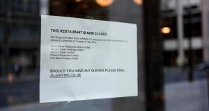 A closure notice stuck to the window of  a Jamie's Italian restaurant in central London. All but three of the British celebrity chef Jamie Oliver's 25 UK restaurants are shutting down after the business called in administrators. Photograph: Facundo Arrizabalaga/EPA