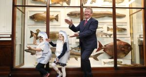 Fishy Fun in the museum:  Evelyn (6)  and  Rory Cahill (4) from Dunboyne doing the 'Baby Shark' dance with Minister  of State Seán Canney at the launch of an  event to mark the International Year of Salmon.