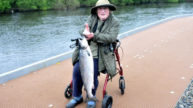 Celia Fry (83) from UK with the first salmon from the disabled anglers' platform on River Moy.