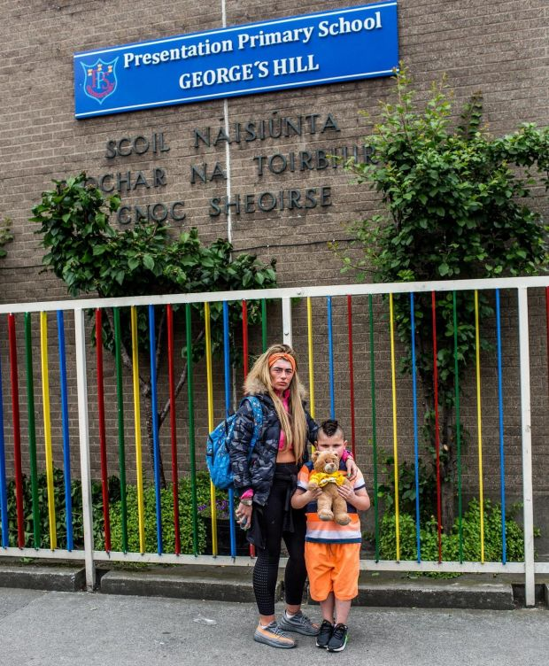 Nadine Staunton and her son Maddix outside Presentation Primary School George's Hill, where he has attended for several years but will no longer have a place in September. Photograph: James Forde