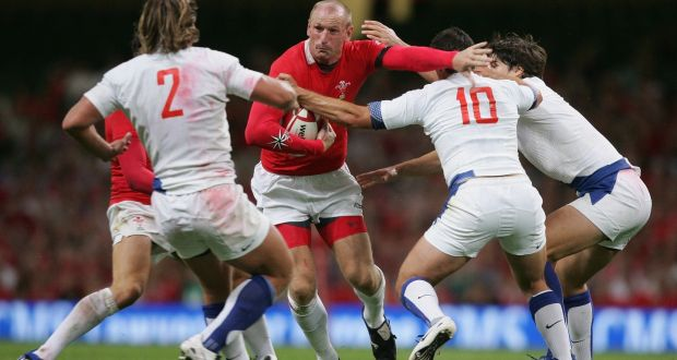 Wales captain  Gareth Thomas is tackled by Lionel Beauxis  and Dimitri Szarzewski of France during a Test match    at the Millennium Stadium  in Cardiff. Photograph: David Rogers/Getty Images