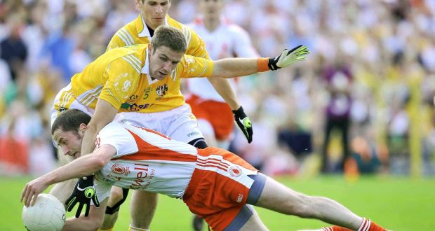 Tyrone's Stephen O'Neill and Antrim's Tony Scullion during the Ulster  Championship final in 2009. Photograph: Presseye/Russell Pritchard