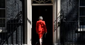 British prime minister Theresa May leaves after delivering a statement in London on Friday. Photograph: Toby Melville/Reuters