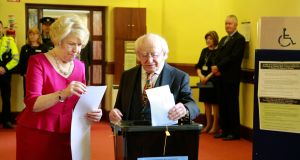 President Michael D Higgins and Sabina Higgins have cast their vote this morning at St Mary's in the Phoenix Park. Photograph: Nick Bradshaw