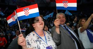 Croatian citizens at a political rally in  Zagreb. Photograph: Antonio Bat/ EPA