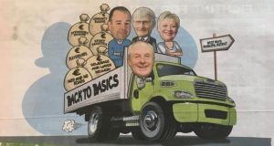 In an advertisement in the Mayo News, Minister for Rural and Community Development Michael Ring is depicted driving a truck whose cargo is Fine Gael local election candidates and bags of money.