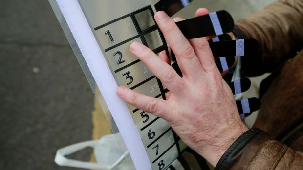 Robbie Sinnott with the template he used to help negotiate his ballot paper. Photograph: Nick Bradshaw/The Irish Times
