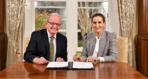 University of Limerick president Dr Des Fitzgerald formally signs the contract with Dunnes Stores executive Anne Heffernan. Photograph: Diarmuid Greene/True Media