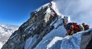 A queue of mountain climbers waiting to stand at the summit of Mount Everest this week. Photograph:  Handout/Project Possible/AFP/Getty Images