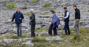 King Carl XVI Gustaf and Queen Silvia of Sweden visit an eco-farm on the Burren, with Dr Brendan Dunford, manager of the Burren programme, Vincent Keane, farmer and Joe Burke, meat and livestock manager, Bord Bia. Photograph: Julien Behal
