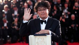 South Korean director Bong Joon-ho poses with his Palme d'Or at the Cannes Film Festival, in Cannes, France. Photograph: Ian Langsdon/EPA