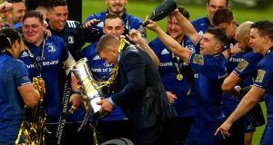 Leinster's Sean O'Brien celebrates with the Pro14 trophy. Photograph: James Crombie/Inpho