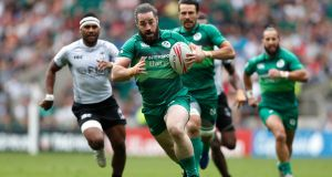 Ireland's  Mick McGrath on the way to scoring a try during the quarter-final match against  Fiji  at the  HSBC London Sevens at Twickenham. Photograph: Luke Walker/Getty Images