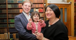 Green Party winners Patrick Costello and Hazel Chu with their daughter Alex in the RDS, Dublin. Photograph: Gareth Chaney Collins