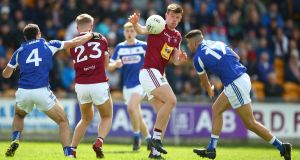 Westmeath's John Heslin and Robbie Piggott of Laois in action during the Leinster championship clash at O'Connor Park, Tullamore. Photograph: James Crombie/Inpho
