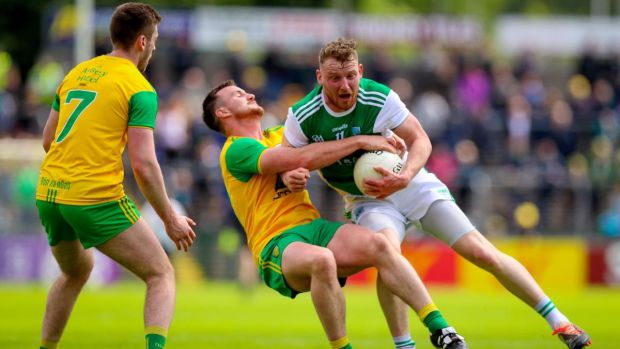 Aidan Breen of Fermanagh holds off Donegal's Leo McLoone during the Ulster SFC quarter-final at Brewster Park in Enniskillen. Photograph: Tommy Dickson/Inpho