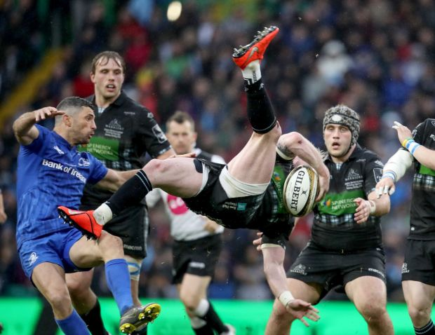 Glasgow Warriors' Stuart Hogg falls to the ground after a tackle from Rob Kearney. Photograph: Dan Sheridan/Inpho