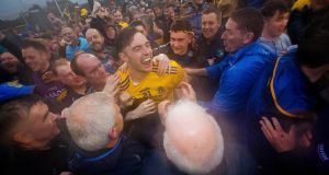 Roscommon's Andrew Glennon celebrates with delighted fans after the victory over Mayo in Castlebar. Photograph:  Ryan Byrne/Inpho