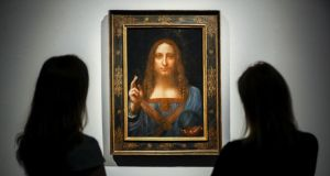 Salvator Mundi: the painting sold for $450 million  after being attributed to Leonardo da Vinci. Photograph: Tolga Akmen/AFP/Getty
