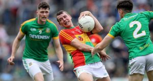 Carlow's Sean Gannon in action against Meath's Séamus Lavin. Meath had 15 points to spare against their outclassed Leinster rivals as they won 2-18 to 0-9. Photograph: Bryan Keane/Inpho