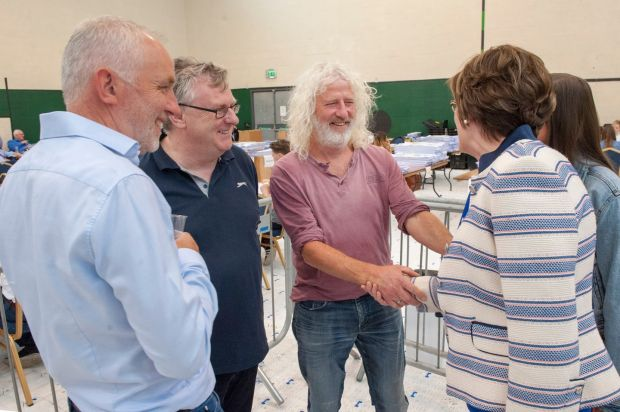 Candidate Mick Wallace is greeted by Seán Kelly's wife Juliette pictured at the Ireland South constituency count centre in Nemo, Cork. Phototgraph: Daragh Mc Sweeney/Provision