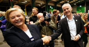 The Green Party's Ciarán Cuffe shakes hands with Fine Gael's Frances Fitzgerald at the count centre in the RDS on Monday night. Photograph Nick Bradshaw/The Irish Times