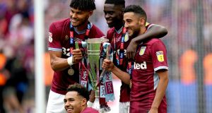 Aston Villa's Tyrone Mings (left) Axel Tuanzebe, Neil Taylor and Andre Green celebrate their promotion to the Premier League. Photograph: John Walton/PA