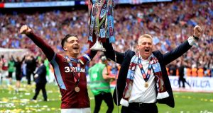 Jack Grealish and Dean Smith celebrate Aston Villa's promotion to the Premier League. Photograph: Mike Egerton/PA