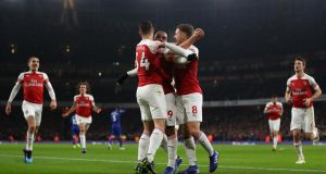 Arsenal celebrate Alexandre Lacazette's goal against Chelsea in January. Photograph:  Catherine Ivill/Getty