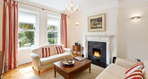 The fireplace in the living room could be replaced with a more restrained Edwardian version
