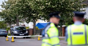 Gardaí at the scene of a fatal shooting incident at Kilbarron Avenue, Coolock, Dublin, on Tuesday. Photograph: Tom Honan