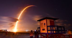 The Falcon 9 rocket with a payload of 60 satellites for the Starlink broadband network lifts off from Florida's Cape Canaveral. Photograph: Malcolm Denemark/Florida Today via AP