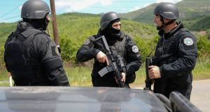 "Members of a Kosovo  special police unit  near the village of Cabra, northwestern Kosovo, during  police raids. The  operation against ""organised crime"" has sparked tensions with Serbia.  Photograph: AP Photo/Visar Kryeziu"