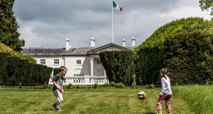 Max and Molly Rooney playing football in front of Áras an Uachtaráin in Phoenix Park. Photograph: James Forde