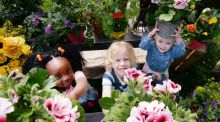 Bloom: five-year-old Adrianna Fayiah, seven-year-old Eoghan Fox and four-year-old Florence Marlow Ward at the launch of this year's Phoenix Park garden festival. Photograph: Alan Betson
