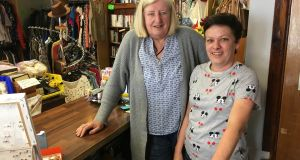 Mary Kelly and Grainne Devine at the Friends of St Brigid's Hospice Charity Shop on Leixlip's Main Street. Devine    believes Intel's presence has had a positive effect on the town. Photograph: Mark Hilliard