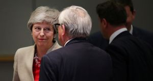Outgoing UK prime minister Theresa May has a Brussels catch-up with European Commission president Jean-Clause Juncker. Photograph: Francisco Seco/Pool via Reuters.