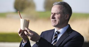 Prof Tom Curran, AgroCycle project co-ordinator and assistant professor in Biosystems and Food Engineering at University College Dublin with an 'edible straw' and drinking cup made from potato pulp. Photograph: Conor McCabe Photography.