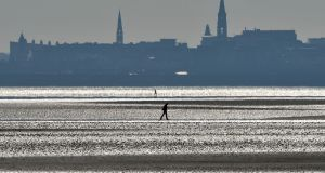 Three of the five waters classified as being poor are in the Dublin  region: Merrion strand, Sandymount strand (above) and Portrane beach.  Photograph: Alan Betson / The Irish Times