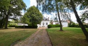 This French hunting lodge for  nobility comes with two outbuildings.
