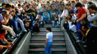 Diego Maradona emerges into the San Paulo stadium for his media presentation after signing for Napoli. Photograph: Alfredo Copozzi
