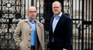 Investigative journalists Barry McCaffrey (left) and Trevor Birney standing outside Belfast high court on Wednesday. Photograph: Liam McBurney/PA Wire