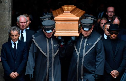 FINAL LAP: French former Formula One driver Alain Prost and world champion Lewis Hamilton walk next to the coffin of Austrian three-time world champion Niki Lauda as it is being carried out of the Stephansdom (St Stephen's Cathedral) in Vienna. Photograph: Joe Klamar/AFP/Getty Images