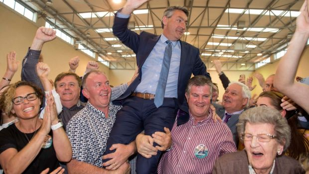 Billy Kelleher (FF) is held aloft by supporters at Nemo Rangers GAA Club in Co Cork after being elected an MEP in Ireland South. Photograph: Michael Mac Sweeney/Provision